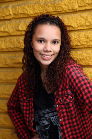 Senior photo on yellow brick wall in Everett, WA