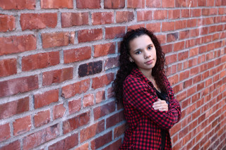 Senior photo on brick wall in Everett WA