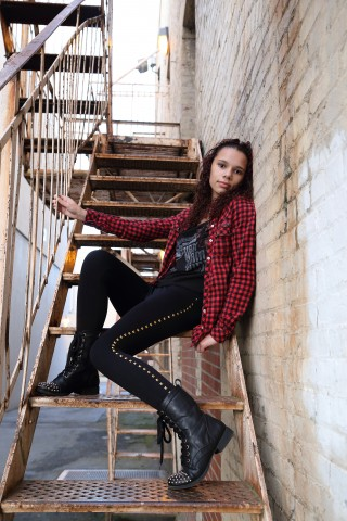 Senior photo on fire escape in Everett, WA