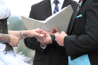 The groom places the ring on the bride's hand