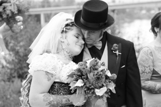 A bride and groom enjoy a quiet moment of post-wedded bliss