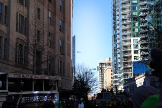 12 man flag flies in distance - Seattle Seahawks Super Bowl Victory Parade in Seattle, WA - February 2014