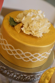 Gold dusted wedding cake with sugar flowers