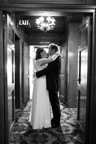 Bride and Groom embrace in a hall at the Sorrento Hotel in Seattle, WA
