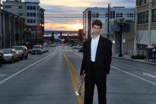 Senior guy in tux with sunset