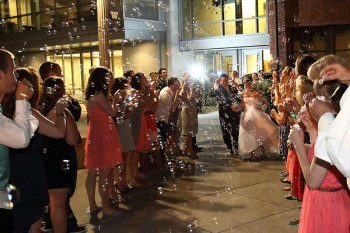 Bride and Groom make their grand exit in a sea of bubbles