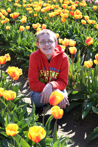 Teenage boy in tulips