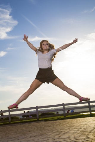 Girl doing split jump in the air