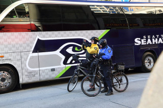 Police taking pics - Seattle Seahawks Super Bowl Victory Parade in Seattle, WA - February 2014