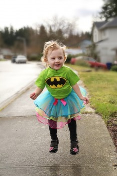 Jumping up and down in her tutu