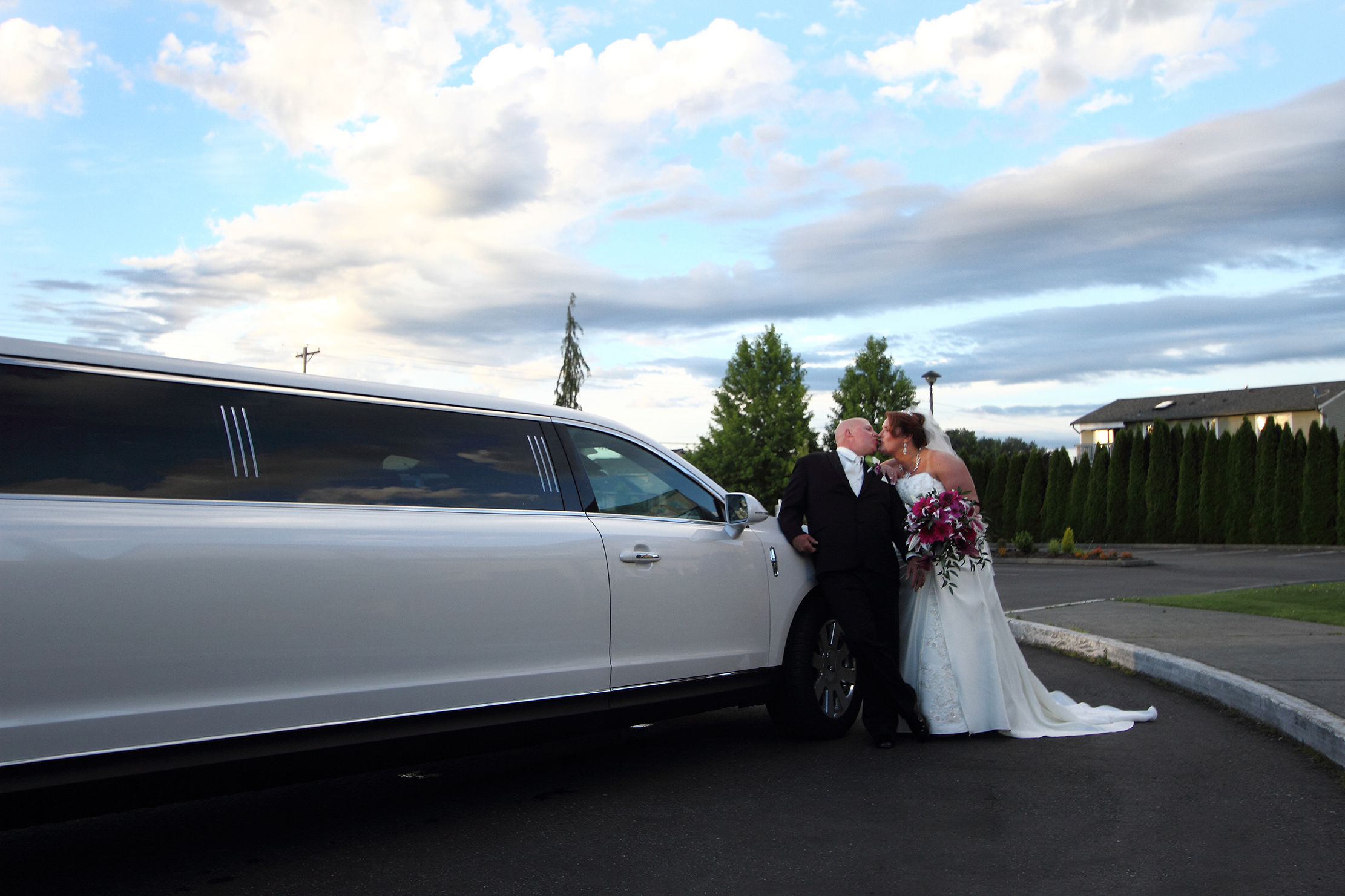 Bride and Groom with Limo