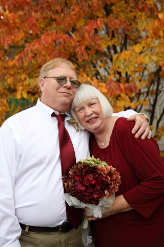 An older Bride and Groom during fall