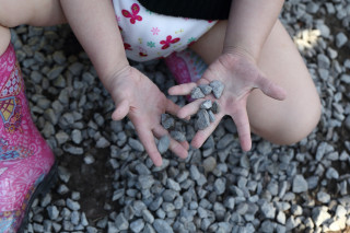 Toddler playing with gravel